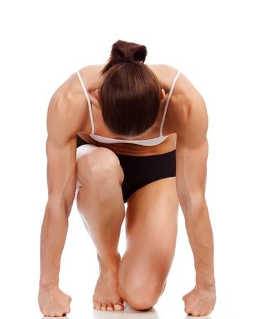 triceps: Female fitness bodybuilder posing against white background