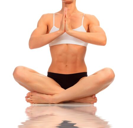 Muscular woman doing yoga exercise, isolated on white background Stock Photo - 12499161