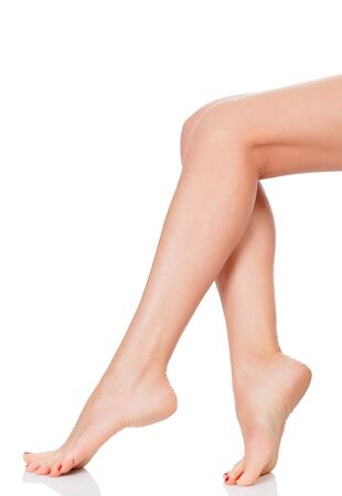 Perfect female legs, isolated on white background  photo
