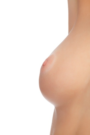 Naked female breast against white background photo