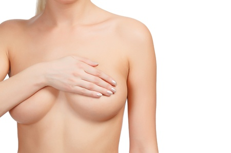 breasts erotic: Cropped image of a female controlling breast for cancer, isolated on white background.  Stock Photo