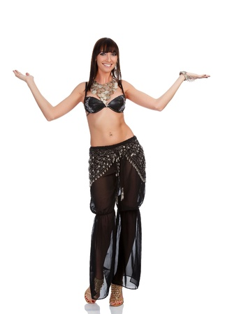 Pretty belly dancer in black costume, isolated on a white background.  photo