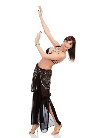 Full length portrait of belly dancer in black costume, isolated on a white background photo