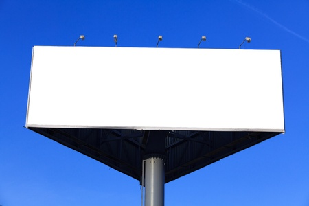 Blank billboard against clear blue sky photo