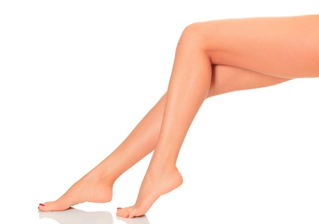 fine legs: Well-groomed female legs. Isolated on white background.