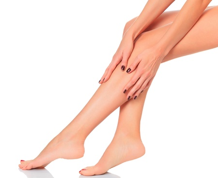 Well-groomed female legs after depilation. Isolated on white background.  photo