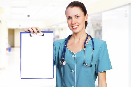nurse clipboard: Female doctor with the blank paper on clipboard