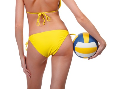 female volleyball: Woman with a ball posing against white background. Stock Photo