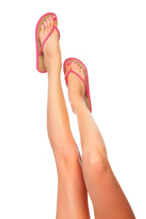 long toes: Female legs with flip-flops, isolated on white background.