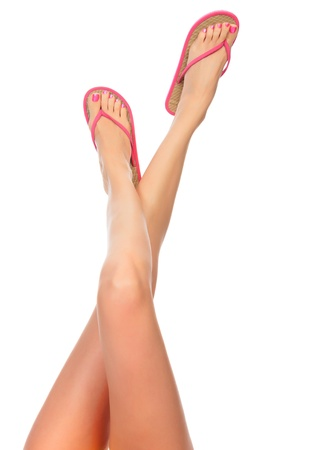 human toe: Female legs with pink flip-flops, isolated on white background