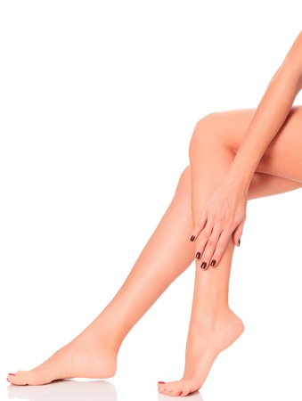 Well-groomed female legs after depilation procedure  A day at a spa concept  Isolated on white background  Stock Photo - 12788055