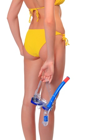 Woman with goggles and snorkel posing against white background photo