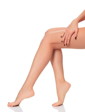 Beautiful femal legs on white background photo