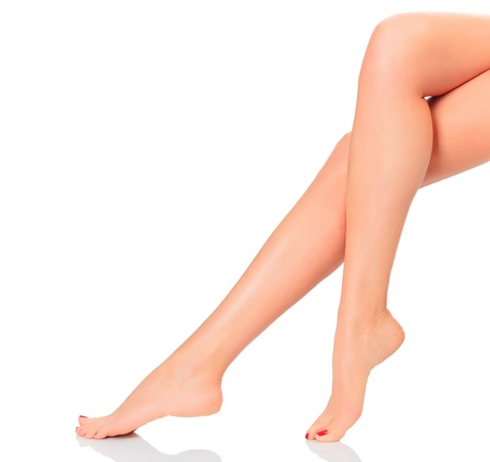 Neat femal legs on white background photo