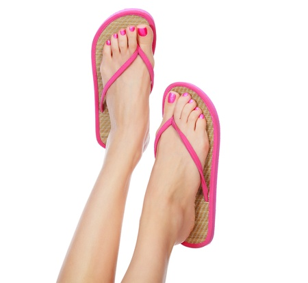 woman sandals: Funny pink sandals on female feet. Isolated on white background.
