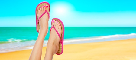 long toes: Pink sandals on woman legs. Summer time concept Stock Photo