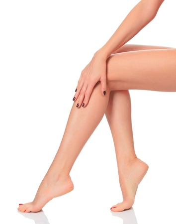Smooth female legs against white background