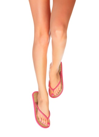 Female legs with flip-flops, isolated on white background. Stock Photo - 13036492