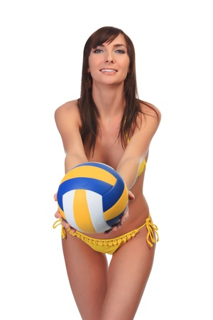 Pretty girl in yellow swimsuit holds a ball photo