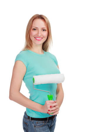Smiling woman with a brush against the white background