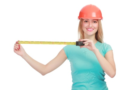 Woman in a helmet with tape measure posing against white background Stock Photo - 13188028