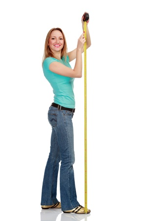 Smiling girl with a tape measure, isolated on white background Stock Photo - 13320938