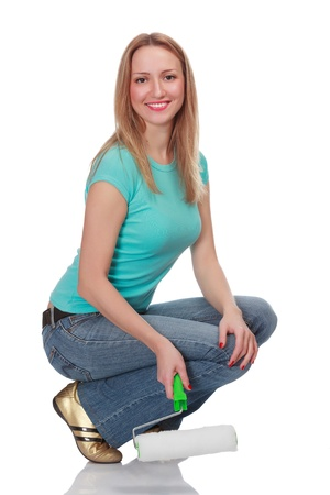 Smiling woman with a brush against the white background. Stock Photo - 13321095