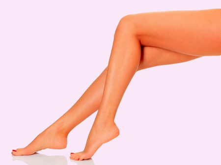 Female legs on pink background photo