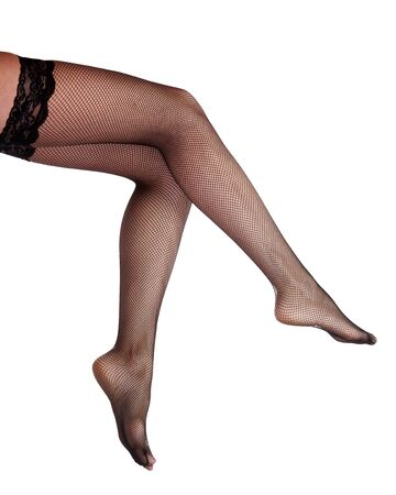 Female legs in black pantyhose, isolated on white Stock Photo - 14017369