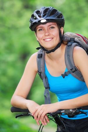 Female biker in a park photo