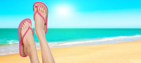 Pink sandals on woman legs. Summer time concept  photo