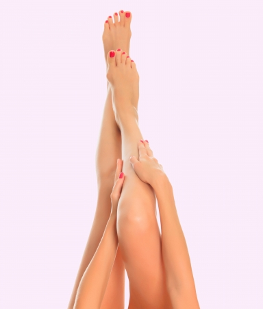 Long female legs on pink background  photo