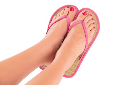 human toe: Female feet with pink flip-flops, isolated on white background.