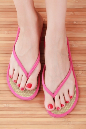 long toes: Female feet with flip-flops Stock Photo