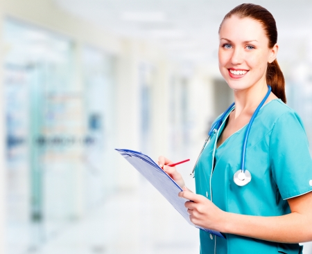 medical uniform: Medical doctor woman in the office  Stock Photo