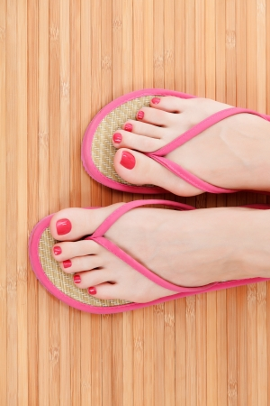 Female feet with flip-flops  photo