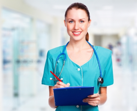 Medical doctor woman in the office smiling to you  photo