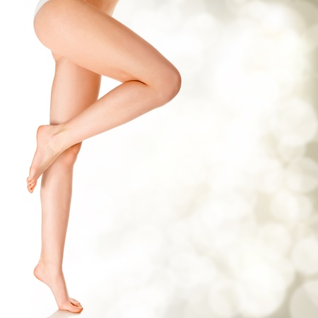shaved: Perfect female legs on golden blurred background