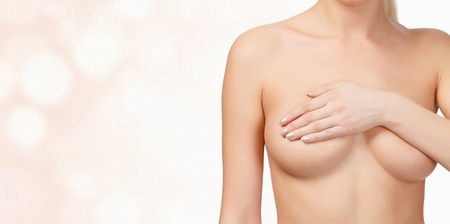 beautiful breasts: female breast on blurred background, breast cancer concept