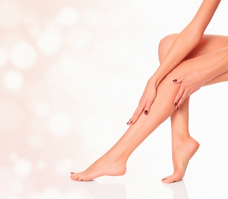 waxed: Perfect female legs on blurred background  Luxury style  Stock Photo