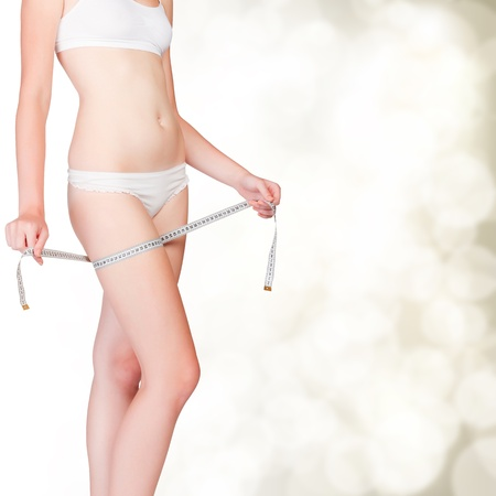 dishy: Woman taking measurements of her body on blurry background with copyspace Stock Photo