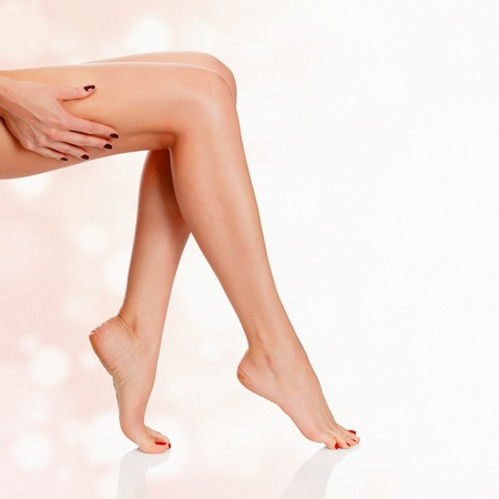 waxed: Perfect female legs on blurred pastel background  Luxury style  Stock Photo