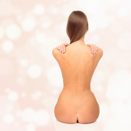 naked female body: Naked woman on pastel background Stock Photo