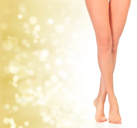 Luxury legs on golden background with blurred lights photo