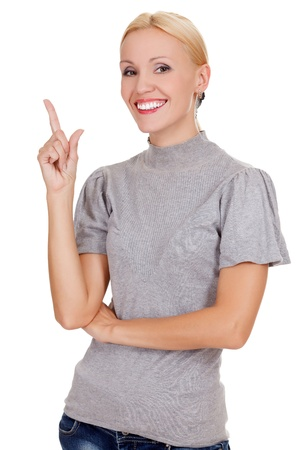 happy young business woman pointing at something interesting against white background  photo