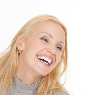 dentalcare: excited young woman laughing against white background