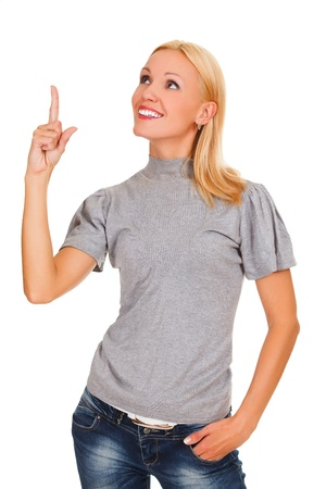 displaying: happy young business woman pointing at something interesting against white background  Stock Photo