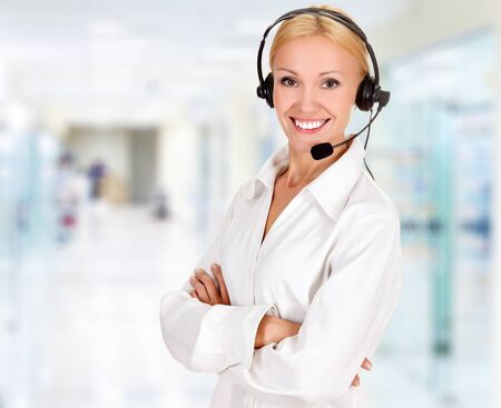 Woman wearing headset in office Stock Photo - 15171832