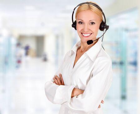 Woman wearing headset in office Stock Photo - 15171832