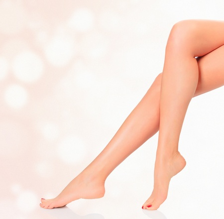 waxed: Legs of a woman against abstract background with circles and copyspace.  Stock Photo